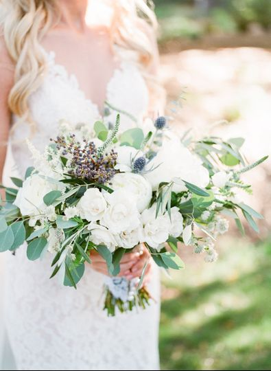 Brides bouquet with white peonies