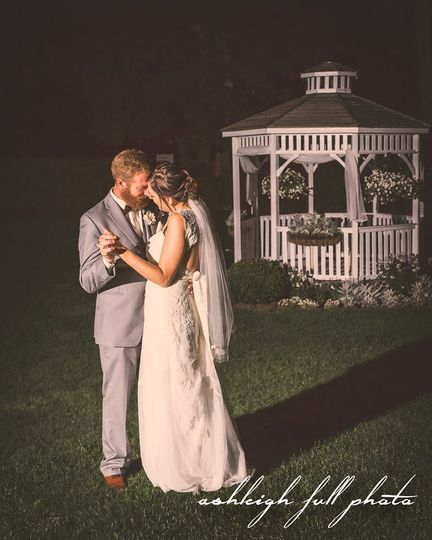 Couple beside gazebo