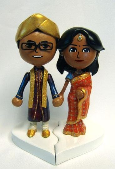 Topper based on user created Miis from the Nintendo Wii, in actual wedding attire.  Traditional...