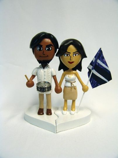 Topper based on user created Miis from the Nintendo Wii, in actual wedding attire.  Both are...