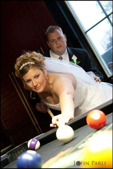 Fun image with bride and groom shooting pool at Union Station in Joliet IL