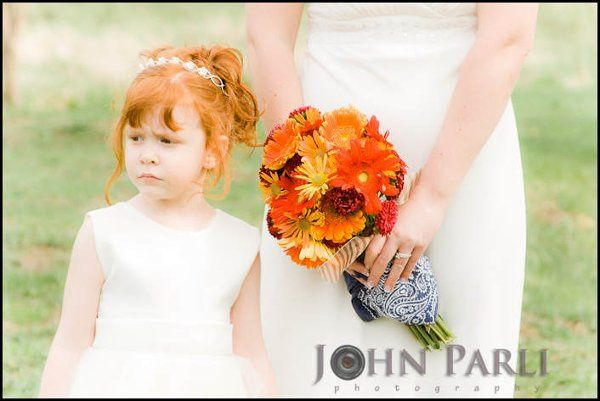 flower girl with bride at outdoor ceremony