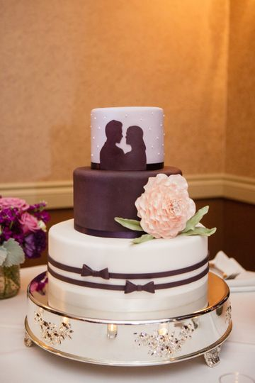 Three tiered, custom wedding cake designed by the bride and groom and made by Let's Do Cake! Hand...