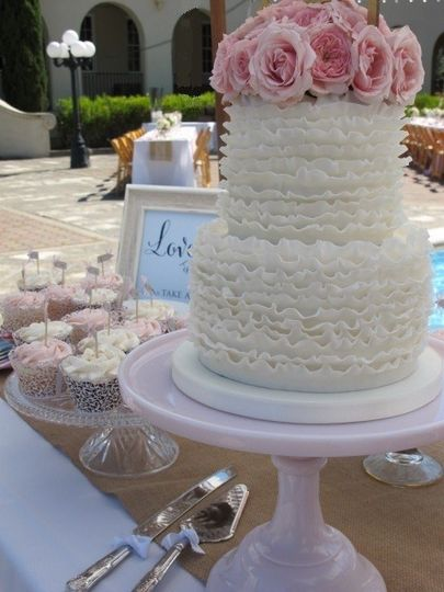 Ruffled Wedding Cake with Fresh Pink Roses and pretty cupcakes for a wedding at St. Vincents in San...