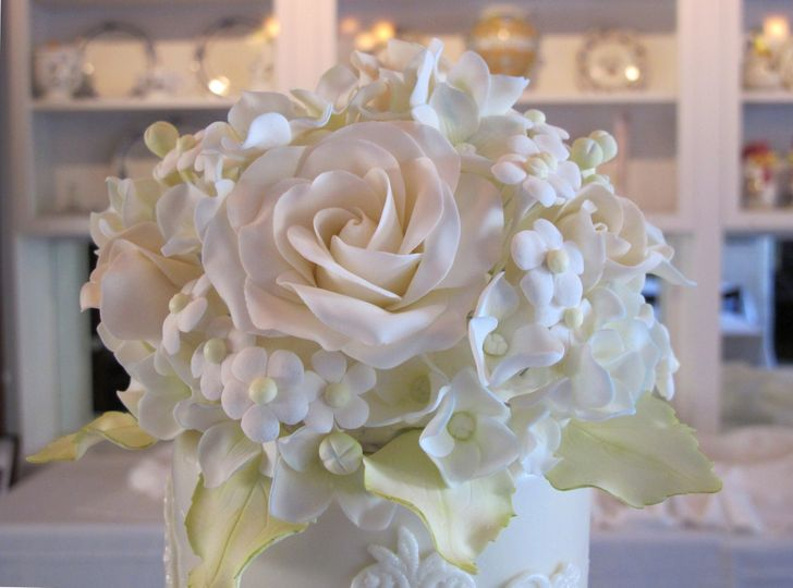 Close up of sugar flower wedding cake topper by Let's Do Cake!