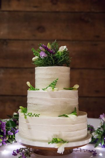 Rustic Frosted Wedding Cake with fresh flowers by Let's Do Cake.  Red velvet cake with cream cheese...