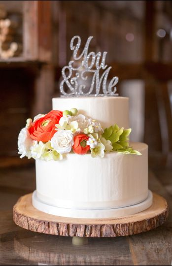 Smooth Italian Meringue Butter Cream frosted wedding cake with handmade sugar flowers.  Purchased...