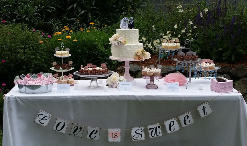 Cake Table by Let's Do Cake with a rustic frosted Wedding Cake with fresh flowers put on by us and...