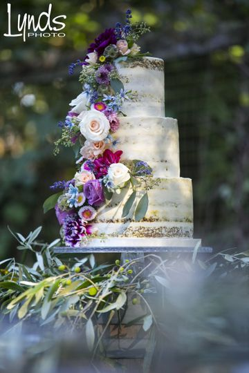 Semi Naked Carrot Wedding Cake with fresh flowers put on by us, Let's Do Cake!