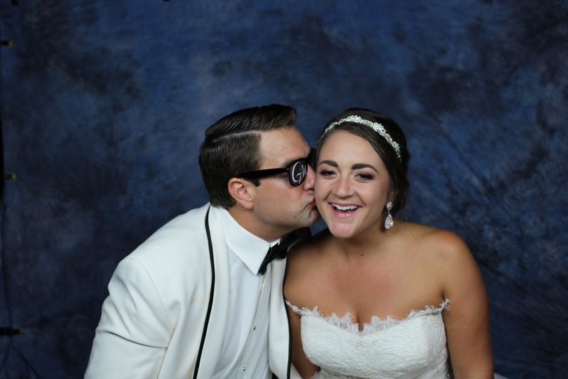 Fun wedding kiss
