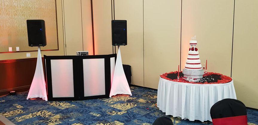 DJ booth and wedding cake display