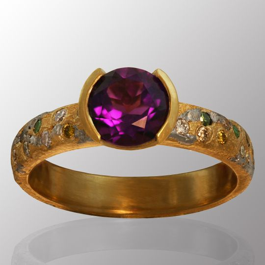 Commission CC made in 18K Yellow Gold & Platinum with an Amethyst center stone and Diamond side...
