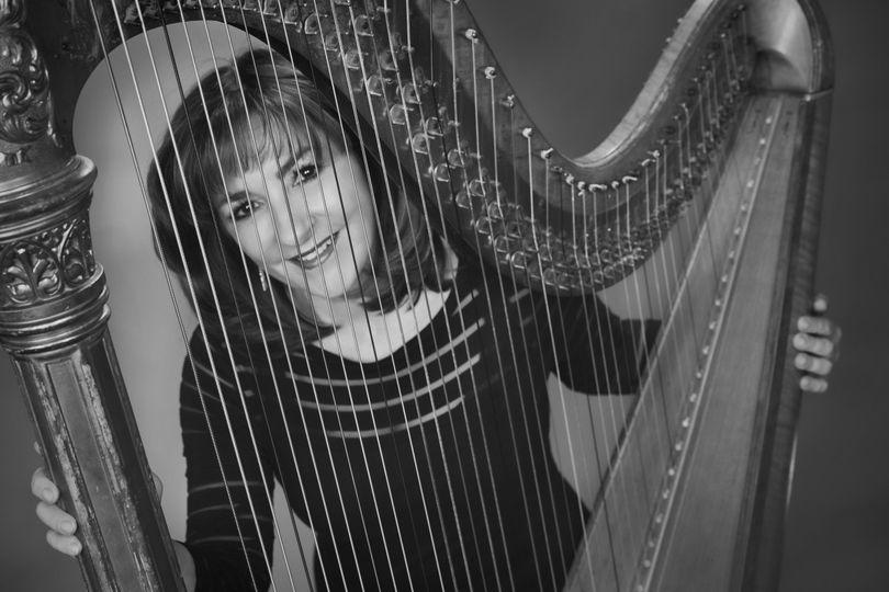 Behind the harp