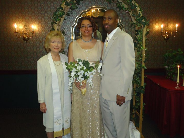 Newlyweds and the officiant