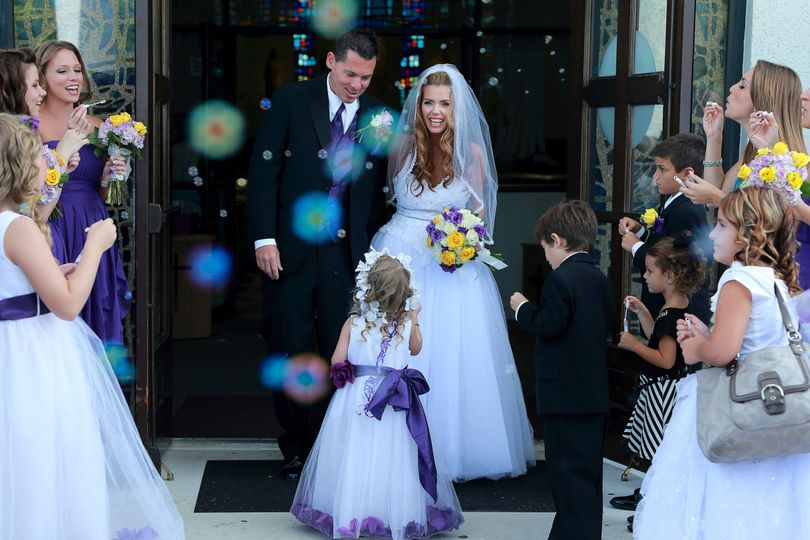 Fort Lauderdale top wedding photographer. Couple exit to bubbles being blown as they left the...
