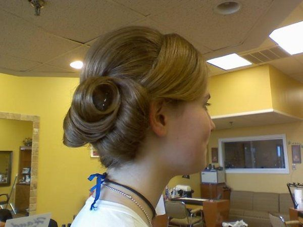 Kirra came into the salon and was modeling at a bridal show! she had the looks! i created a updo as...