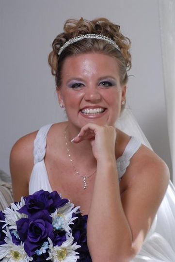 Jennifer was so happy! We also choose this classic updo for her to show off her cute face! we...