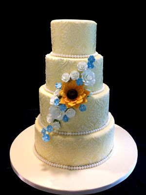 800x800 1509937313188 gold wedding cake with ivory lace and sunflower