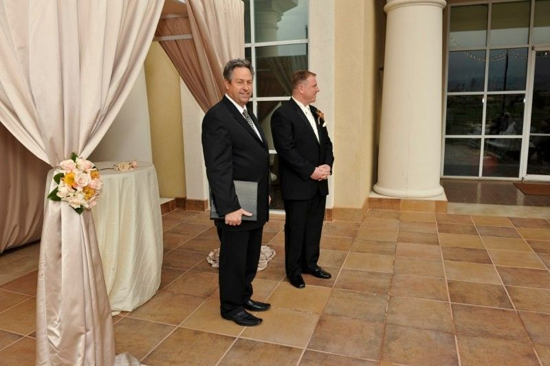 Officiant with the groom