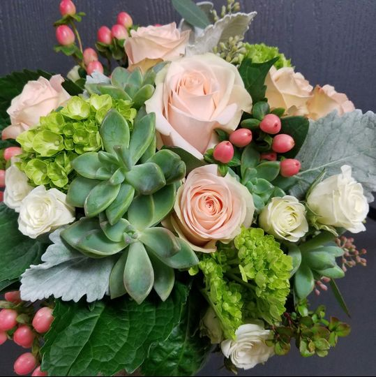 Succulents and peach roses