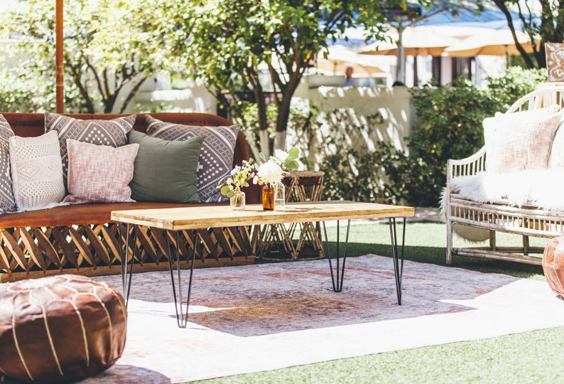 Wooden seats outdoor couch and coffee table setup