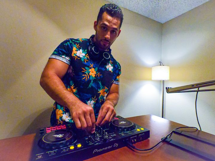 DJ TMajor working on his mixes