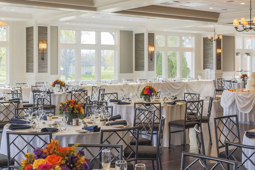 Reception tables with flower arrangements