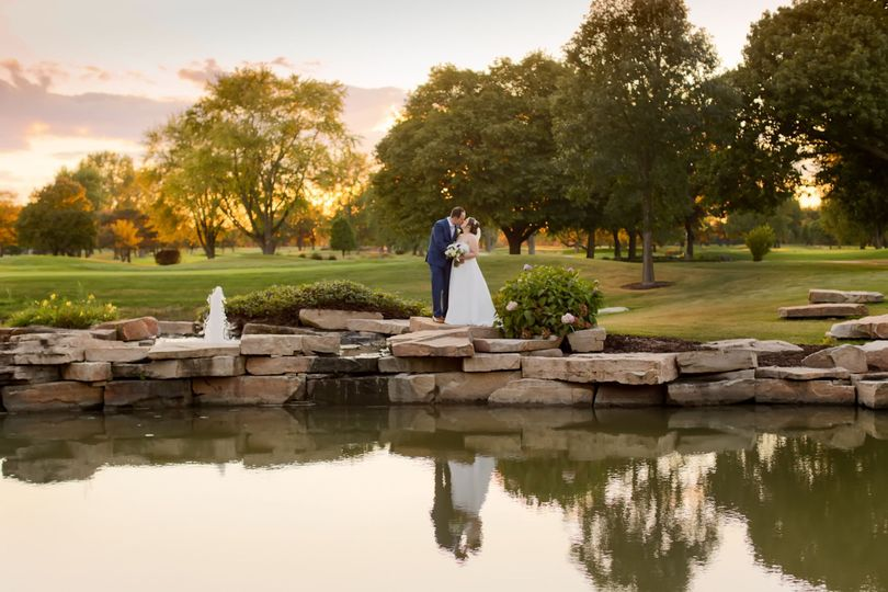 Couple kiss by the pond