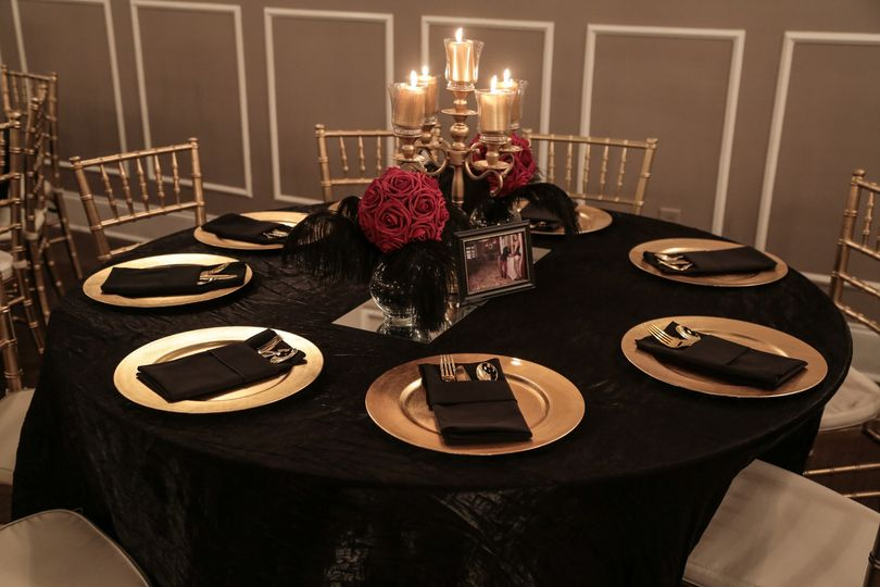 Tables set with gold chargers