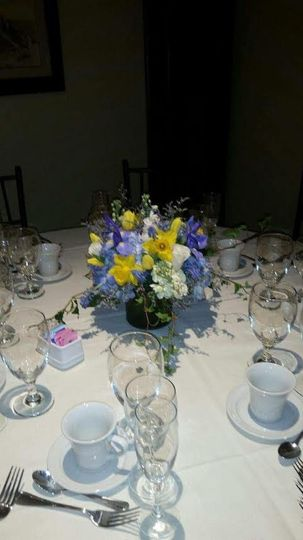 Table setting with a simple, full, spring centerpiece