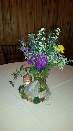 "This bride requested a centerpiece that ""came straight out of middle earth. "" Very garden-y."