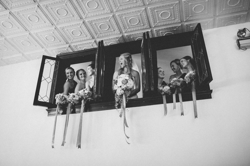 Bridal party by the windows