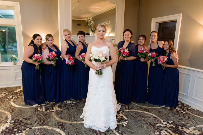Bride with her maid of honor and bridesmaids