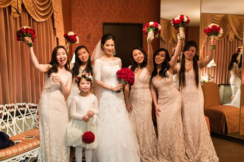 The bride with her bridesmaids and flower girl