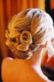 Low soft center bun. Perfect for a beach wedding!
