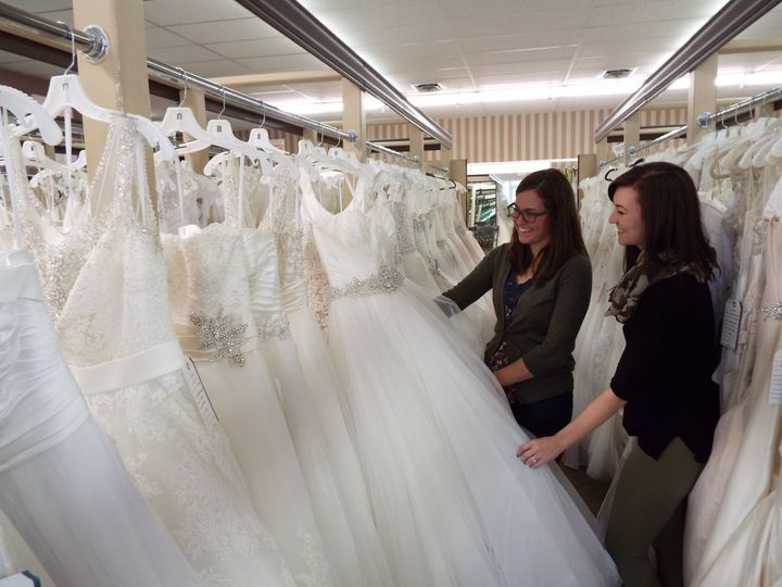 Bride picking out a dress