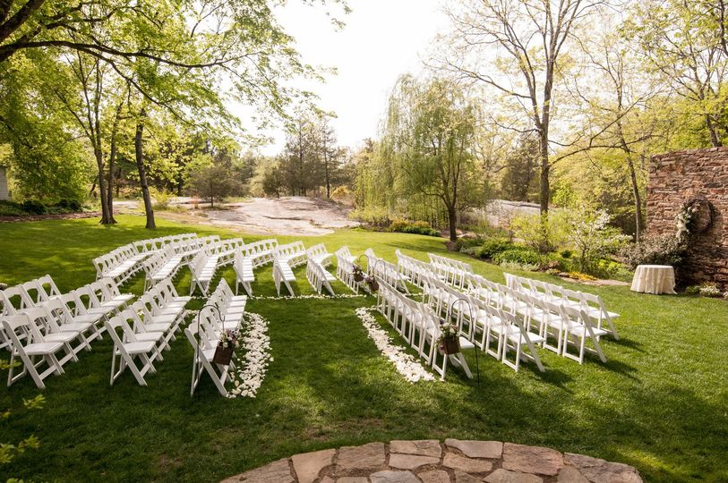 Chairs set up with white petals