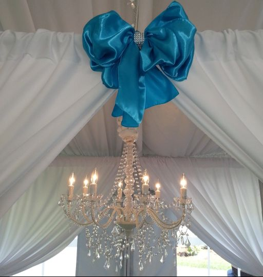 Our drapery and chandelier
