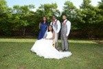 The bride, groom, maid of honor and best man.