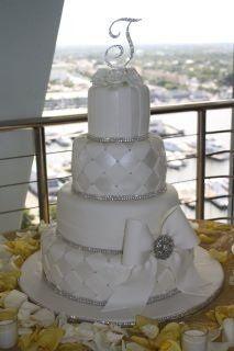 All white wedding cake with white bow