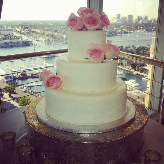 Simple wedding cake with pink flowers