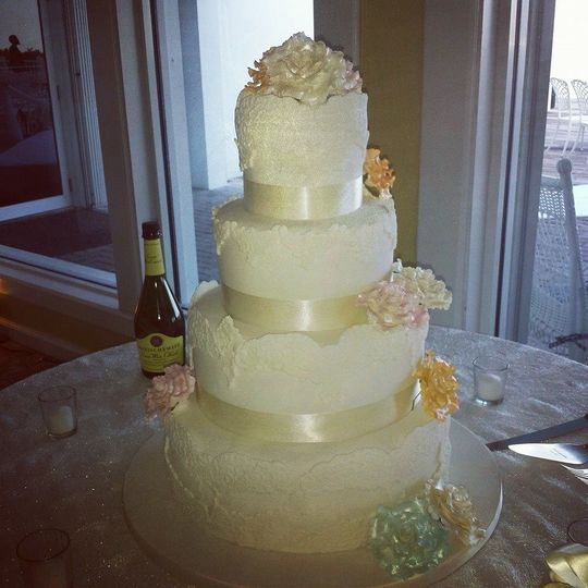 All white wedding cake with flowers
