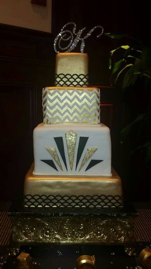 Fancy wedding cake with gold bottom layer