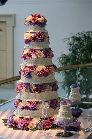 Stand a whopping four and a half feet tall this cake was for a double wedding and was enough to...