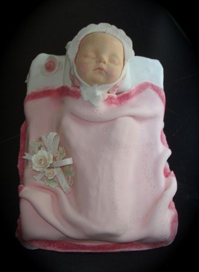 Sleeping baby babt shower cake. Entirely edible airbrushed and hand painted. Iced in buttercream...