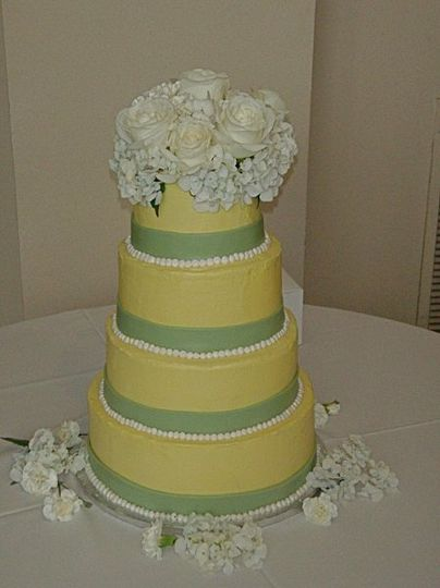 Lemon pound cake layered with cream cheese filling iced in southern vanilla buttercream, adorned...
