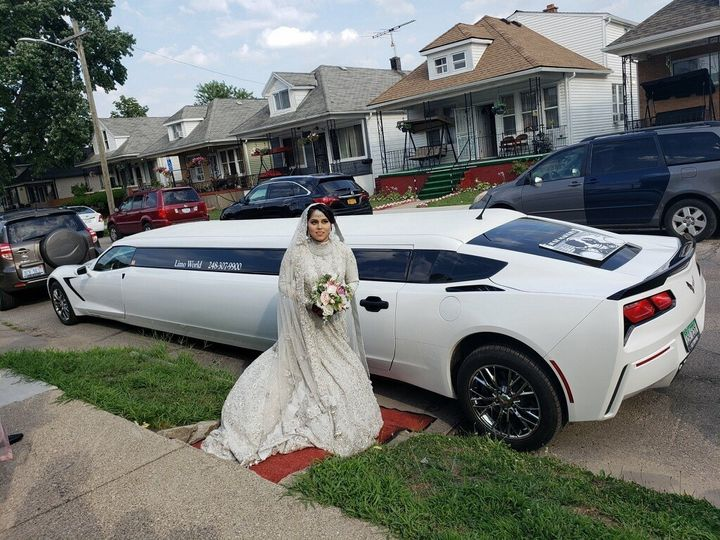Bride in front of Corvette limo