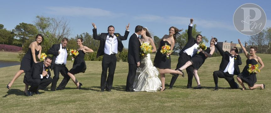 silly bridal party on hill