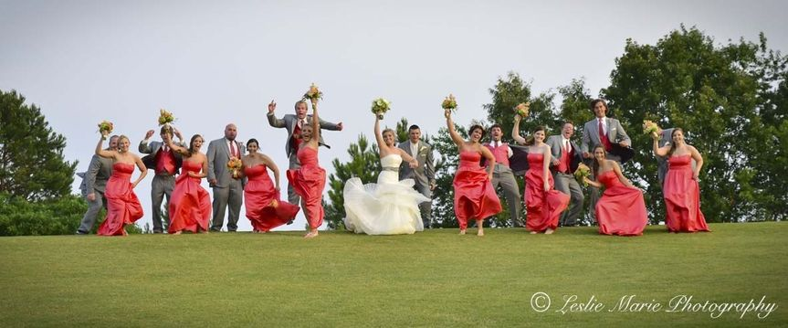 great bridal party photo on hill outside