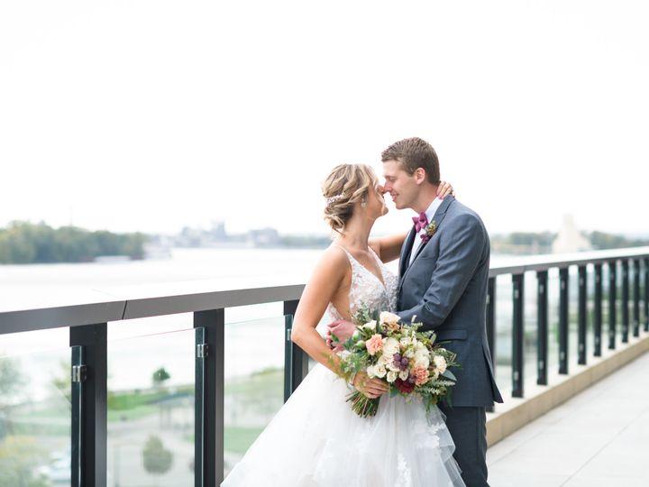 Tmx Merrill Wedding Couple Kiss On Balcony 51 1005157 157541451018462 Muscatine, IA wedding venue
